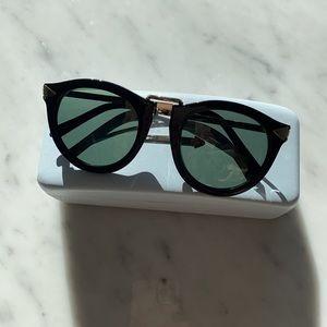 Karen Walker sunglasses.